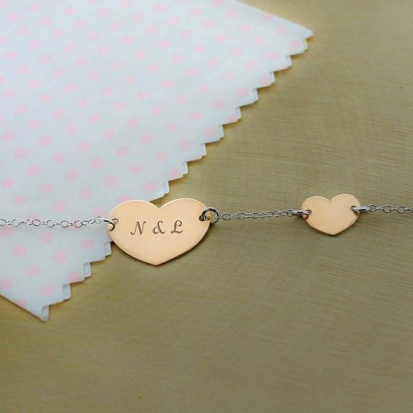 Le bracelet double coeur en Argent rosé