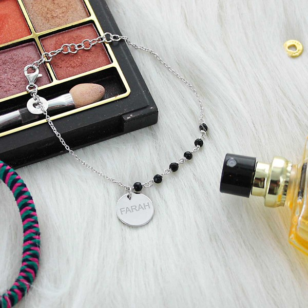 Bracelet médaille et onyx